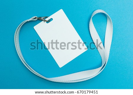 Blank badge or ID pass isolated on blue background, clipping path included #670179451