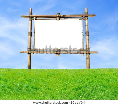 Blank Bamboo Billboard On A Green Hill Over Blue Sky