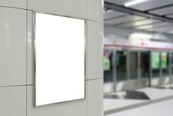 Blank big vertical / portrait orientation billboard on modern white wall with platform background