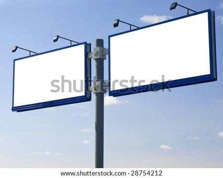 Blank billboard  against a blue sky.
