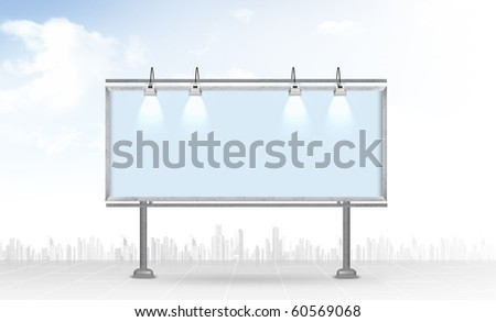 Blank billboard against a city background