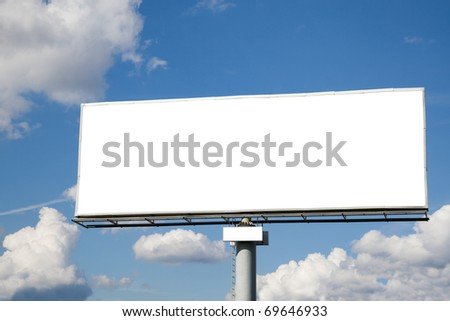 Blank billboard against blue sky with clouds. Useful for your advertisement.