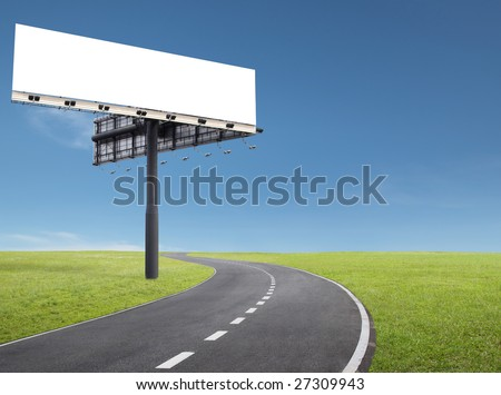 blank billboard at roadside of a curve road