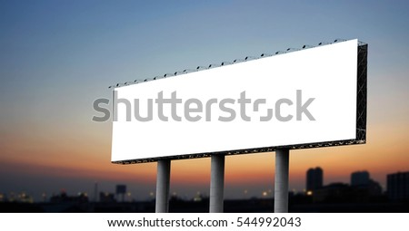 Blank billboard at twilight