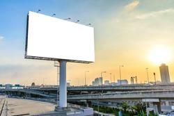 Blank billboard at twilight for advertisement.