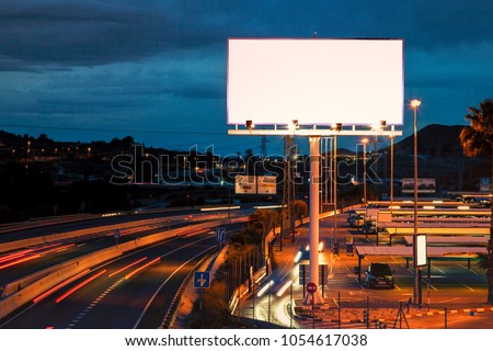 Blank billboard at twilight time for advertisement. Mock up.