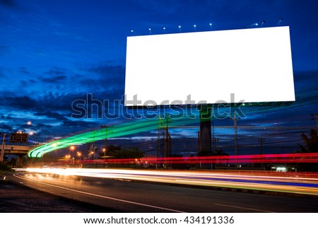 Blank billboard for advertisement at twilight time with light trails on the road at dusk, business advertising concept.  - Shutterstock ID 434191336