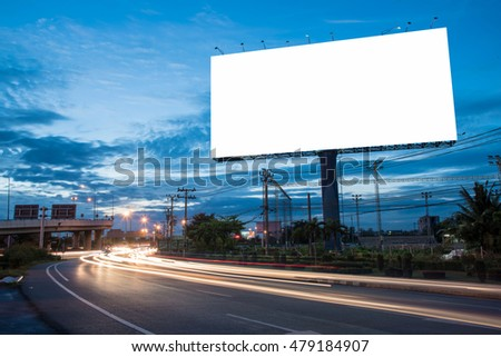 Blank billboard for advertisement at twilight time with light trails on the road at dusk, business advertising concept. - Shutterstock ID 479184907