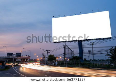 Blank billboard for advertisement at twilight time with light trails on the road at dusk, business advertising concept.   - Shutterstock ID 563771257
