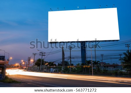 Blank billboard for advertisement at twilight time with light trails on the road at dusk, business advertising concept.   - Shutterstock ID 563771272