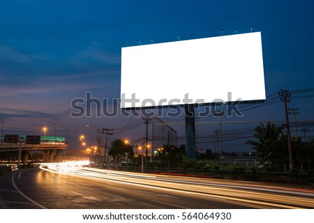 Blank billboard for advertisement at twilight time with light trails on the road at dusk, business advertising concept.    - Shutterstock ID 564064930