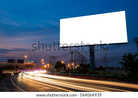Blank billboard for advertisement at twilight time with light trails on the road at dusk, business advertising concept.    - Shutterstock ID 564064939