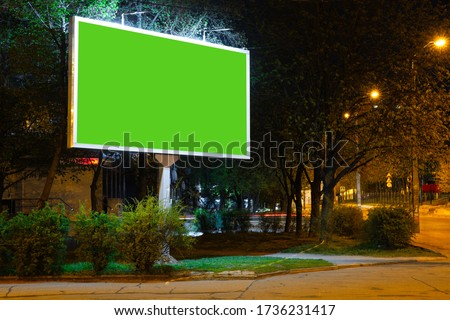 Photo of  Blank billboard for advertising at the city around, copyspace for your text, image, design. Media marketing, ads, promo announcement, commercial propose or message. Banner, template. Chromakey