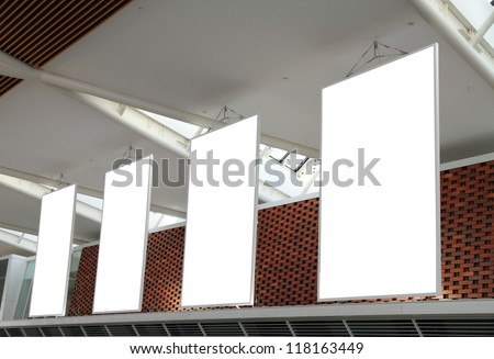 Blank billboard hanging from airport ceiling