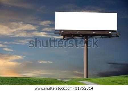 Blank billboard in a field with a blue sky
