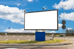 Blank billboard in a parking on a sunny day with clipping path