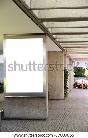Blank billboard in a shopping mall passage - clipping path included