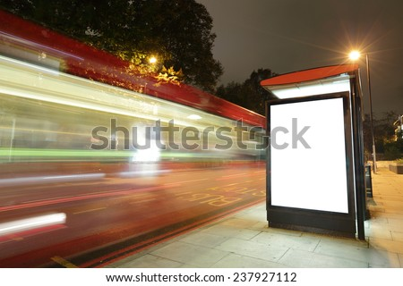 Blank billboard in bus stop at night with the lights of the cars passing by, great copy space for your design, shot in London, United Kingdom, uk