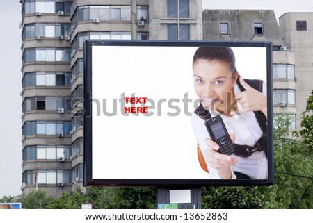 blank billboard in city and young woman
