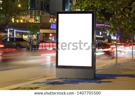 Blank billboard in city traffic