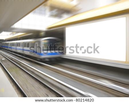 Blank billboard in railway station