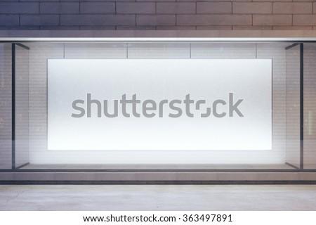 Blank billboard in showcase on evening street, mock up