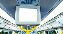Blank billboard in subway train.