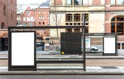 Blank billboard on a bus stop in european town