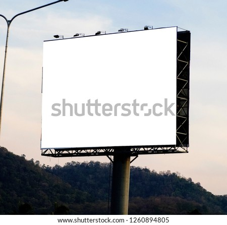 Blank billboard on blue sky background for new advertisement #1260894805