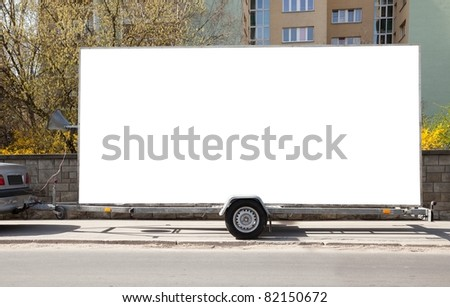 Blank billboard on car trailer