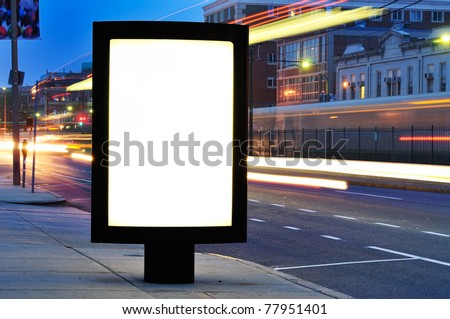 Blank Billboard on City Street at Night