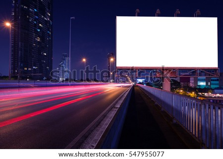 Blank billboard on light trails, street and urban in the night - can advertisement for display or montage product or business. #547955077