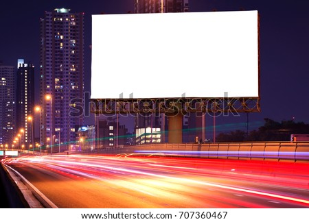 Blank billboard on light trails, street and urban in the night - can advertisement for display or montage product or business. #707360467