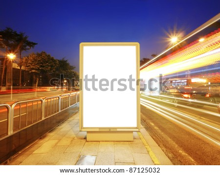 Blank billboard on sidewalk - stock photo