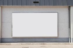 Blank billboard on street wall