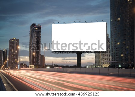 Blank billboard on the highway during the twilight with city background with clipping path on screen.- can be used for display your products or promotional - Shutterstock ID 436925125