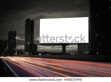 Blank billboard on the highway during the twilight with city background with clipping path on screen.- can be used for display your products or promotional #440835946
