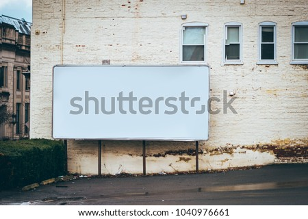 blank billboard on the side of building / advertising space place ad here blank space in parking lot white building editable  #1040976661