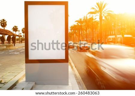 Blank billboard outdoors, outdoor advertising mock up, public information board on city road, flare sun light