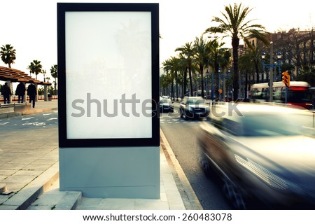 Blank billboard outdoors, outdoor advertising, public information board on city road, filtered image, cross process