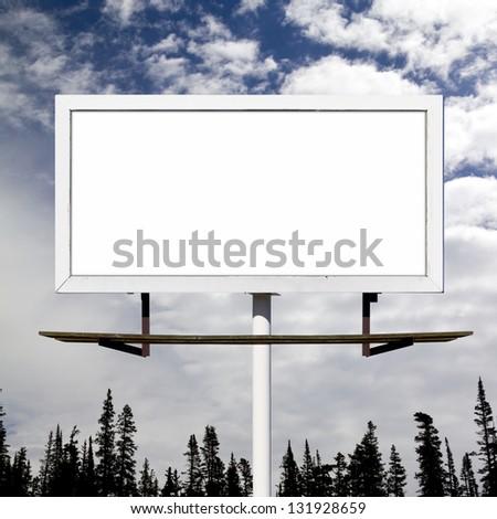 Blank billboard sign against blue sky wilderness background mockup