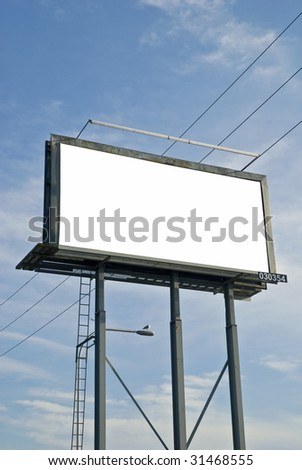 Blank billboard sign with electrical wire and clouds in the background.