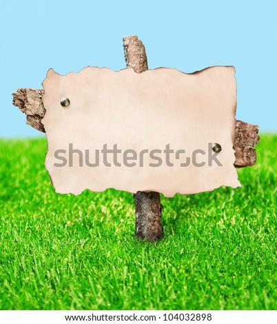 blank billboard stands in a field