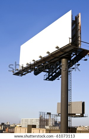 Blank billboard with cityscape