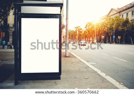 Blank billboard with copy space for your text message or content, public information board on roadside, advertising mock up empty banner in urban areas on a bus stop, clear poster outdoors  ストックフォト ©