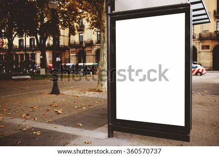 Blank billboard with copy space for your text message or promotional content, public information board on the street, advertising mock up empty banner in metropolitan city, clear poster on a bus stop