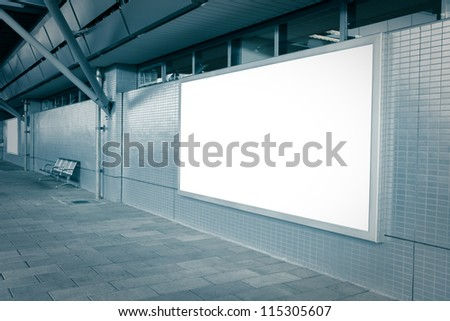 Blank billboard with empty copy space (path in the image) on the street in blue tune