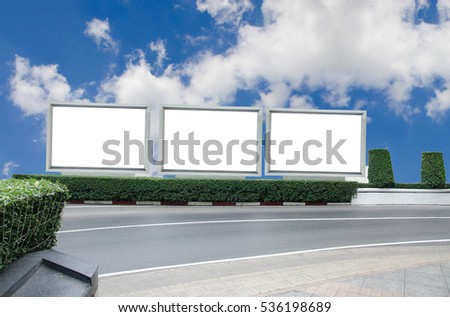 Blank billboards LCD screen light box city for new advertisement commercial with Bush tree nature and blue sky street road concept idea for leave a message information ad white background empty - Shutterstock ID 536198689