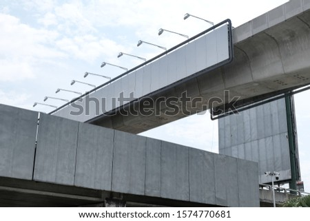 Blank billboards populating and lining motorway bridges at a busy intersection. Advertisement space for rental. Vacant billing boards for advertisers to place ads. Strategic location for ad placement.