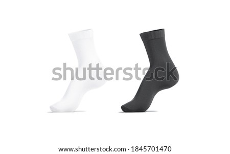 Blank black and white long socks mockup on tiptoe, isolated, 3d rendering. Empty loose stockings clothing mock up, isolated. Clear sport gaiters ped for winter fashion template. ストックフォト ©